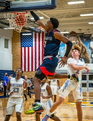 Truman's Najee Williams throws down a dunk in a Phog Allen Invitational semifinal against Raytown Wednesday at William Chrisman High School. Williams scored 19 points and had a pair of thunderous dunks but the Patriots fell 62-48 to the Blue Jays.