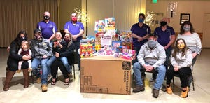 Joining together to help those in need this holiday season are, from left, front, Haley Pelley, Lily Pelley, Bryan Pelley, Heather Young, Lucas Young, Matt Young, Teighan Mills; back, Jerry Skidds, Esteemed Leading Knight and District Deputy, South; Scott Welch, Past Exalted Ruler and Lodge Trustee;  Lynn Welch, Elks toy drive chair and member; Bonnie Skidds , Exalted Ruler, Rochester Elks and Tonya Honaker.