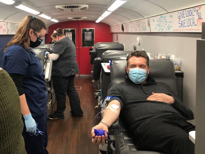 Holt Harrell, a partner at Harrell & Harrell, donates blood during a LifeSouth Giving Tuesday blood drive at the law firm's headquarters in Mandarin.