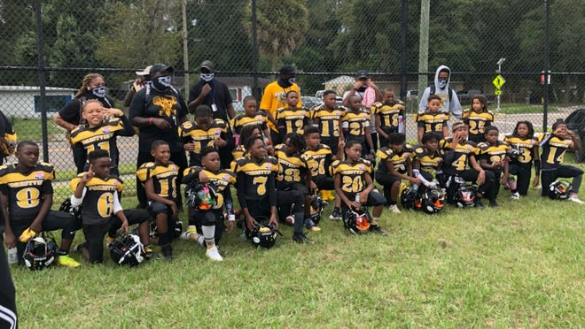The Forestview Athletic Association Outlaws with coaches and team mothers.