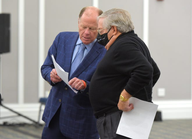 Jacksonville Jaguars President Mark Lamping talks with attorney Paul Harden as they field questions from the Downtown Investment Authority board during a meeting Thursday about the Lot J development deal. The DIA board voted to recommend City Council approve the development deal.