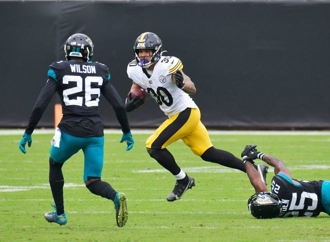 Pittsburgh Steelers running back James Conner (30) is pursued by Jacksonville Jaguars free safety Jarrod Wilson (26) and cornerback D.J. Hayden (25) Sunday, November 22, 2020 at TIAA Bank Filed in Jacksonville, Florida. (Will Dickey/Florida Times-Union)