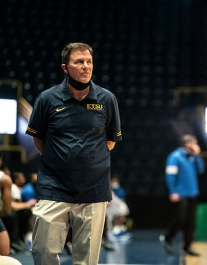 East Tennessee State University men's basketball coach Jason Shay, a 1991 Galesburg High School grad, observes action during last week's Gulf Coast Showcase at Hertz Arena in Estero, Fla. [KEVIN BIRES/For ETSU Athletics]