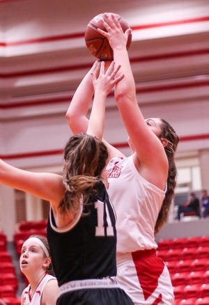 Glen Rose's Aimee Flippen goes up high for the jumper on Tuesday against Grandview.