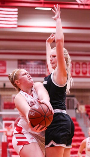 Glen Rose's Jeana Douglas maneuvers around a Grandview defender while trying to put up a shot.
