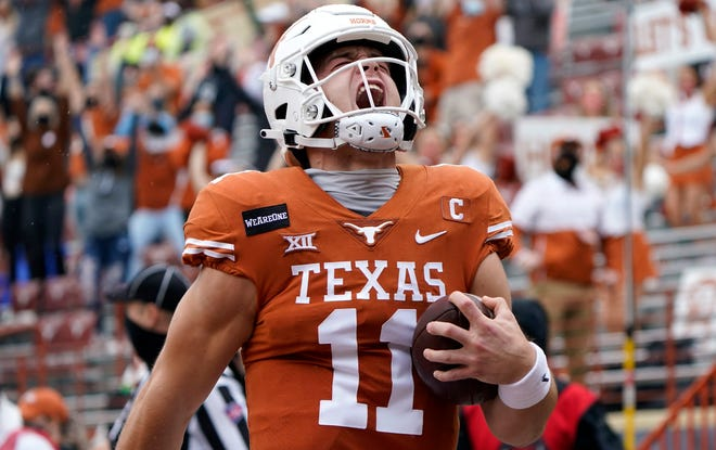 Texas quarterback Sam Ehlinger (11) reacts as he runs for a 17-yard touchdown against Iowa State during the first half on Nov. 27 in Austin.