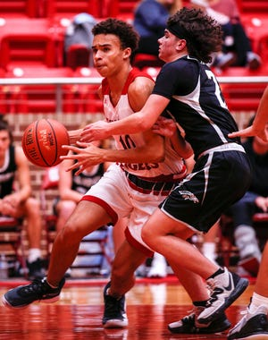 Glen Rose's Caden Smith drives around a Grandview defender on Tuesday.