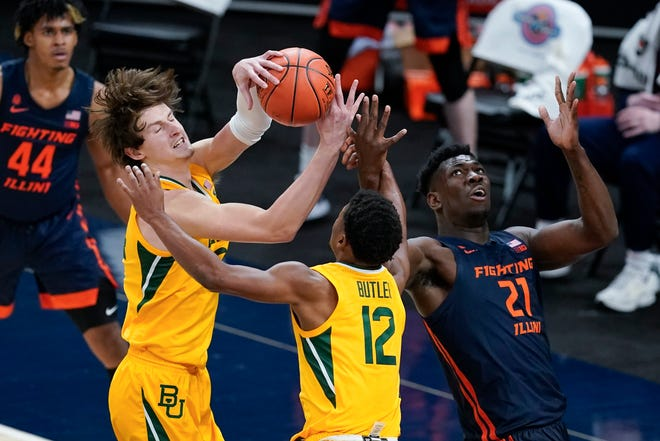 Baylor's Matthew Mayer (24) takes the rebound away from Illinois' Kofi Cockburn (21) as Butler's Jared Butler (12) watches during the second half of an NCAA college basketball game Wednesday in Indianapolis.