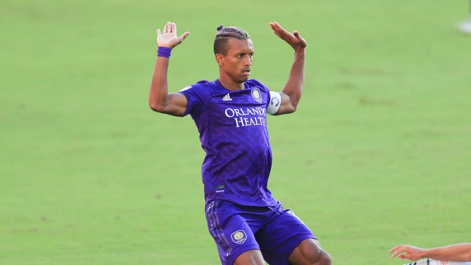 Orlando City forward Nani (17) gestures against New England Revolution during an MLS playoff soccer match, Sunday, Nov. 29, 2020, in Orlando, Fla. (AP Photo/Matt Stamey)