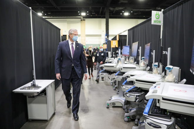 Gov. Charlie Baker was in Worcester on Thursday, Dec. 3, to tour a new field hospital opening there at the DCU Center as coronavirus numbers surge throughout Massachusetts.