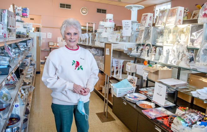 Owner Dorothy Pitcher stands among shelves filled with bakery and cake-related items Thursday, Dec. 3, 2020 at The Cake Shoppe, 5701 S. Adams St. in Bartonville. The shop will be closing for good on Dec. 22 after 43 years in business.