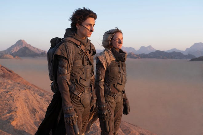 "This image released by Warner Bros. Entertainment shows Timothee Chalamet, left, and Rebecca Ferguson in a scene from the upcoming 2021 film ""Dune."" Warner Bos. Pictures on Thursday announced that all of its 2021 film slate will stream on HBO Max at the same time they play in theaters."
