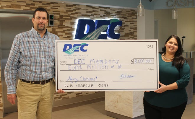Delaware Electric Cooperative Senior Vice President of Member Services Rob Book and Co-op Public Relations Manager Lauren Irby hold a check for members.