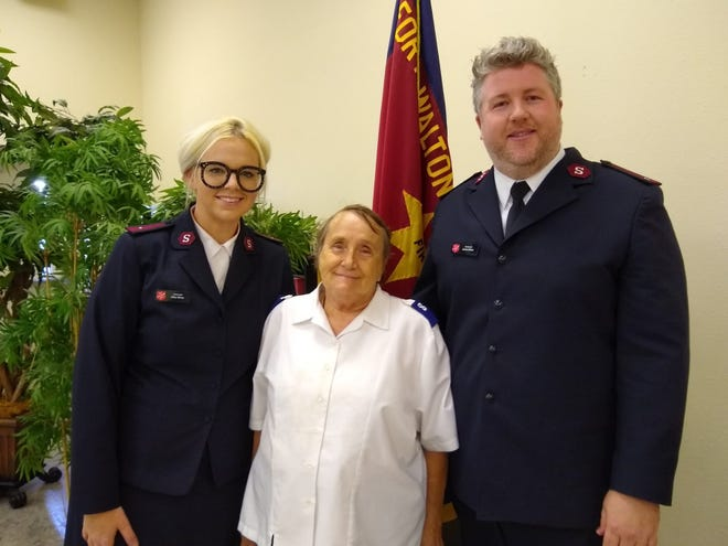 Salvation Army volunteer Kathleen Ruland overcame homelessness and now serves her church, with admiration from Lt. Abby Milner and Lt. James Milner.
