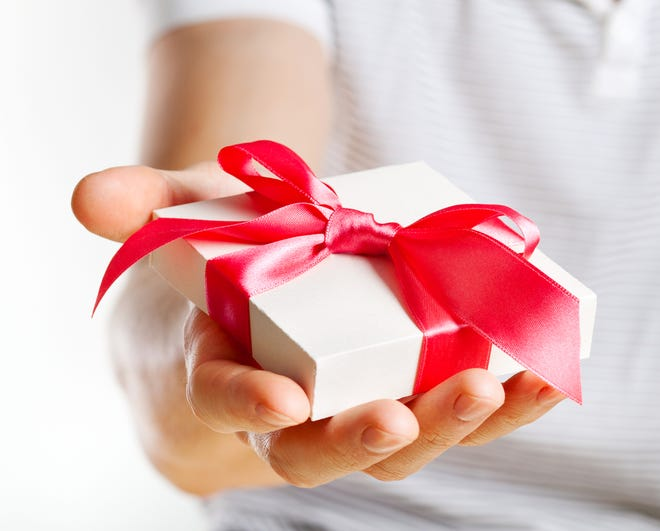 Gift box in man's hand.