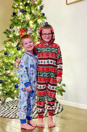 Jaxson Lee, 4, and Rylan Lee, 7, are dressed for a winter's sleep in anticipation of Santa's arrival in three weeks. Jaxson and Rylan are sons of Dustin Rambo and Scarlet Rambo of Pontiac.