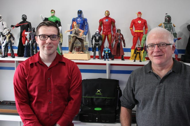 Brandon Rothwell (left) and his father Bob are opening Reality Check Gaming Saturday, which specializes in selling used retro video games and consoles. [Alexander LaCasse/Seacoastonline]