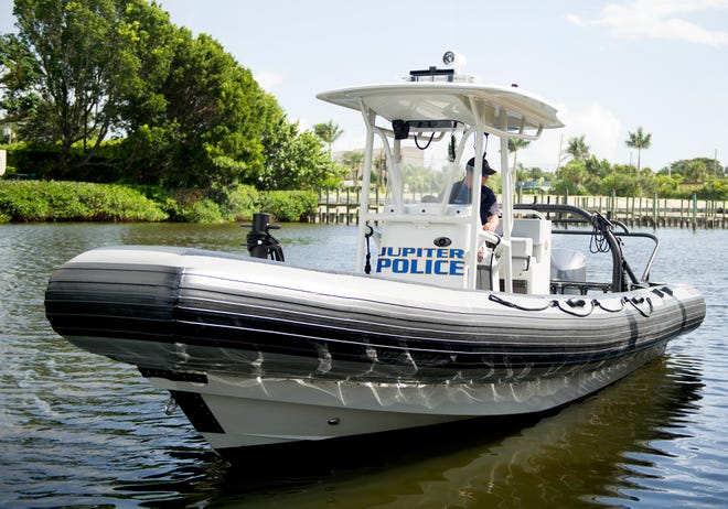 A Jupiter Police Department officer patrols the town with a police boat September 8, 2016.