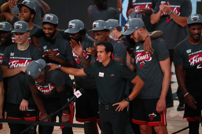Miami Heat head coach Erik Spoelstra and his players celebrate after defeating the Boston Celtics in Game 6 of the Eastern Conference Finals last season. Spoelstra said his team will remain vigilant amid the continuing pandemic.