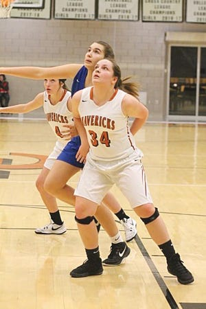 Kiowa County Lady Maverick seniors Gracie Gray and Ellery McMurry battle for defensive postion in a 2019 basketball game. They are happy to get the opportunity to play in 2020, after KSHSAA official announced last week that high school basketball games will go forward as planned, but parents and other spectators will not be allowed in the gyms.