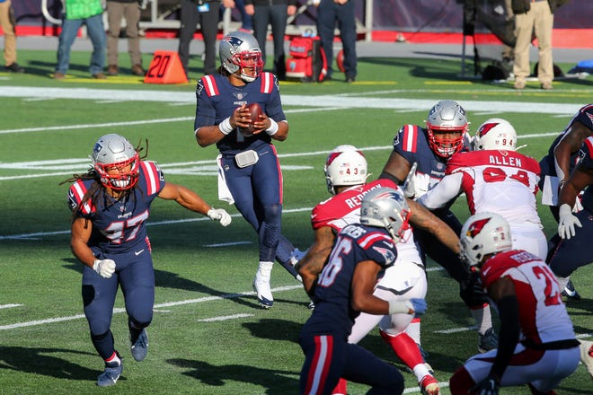 Patriots quarterback Cam Newton drops back to pass during the first half against the Arizona Cardinals Sunday in Foxboro.