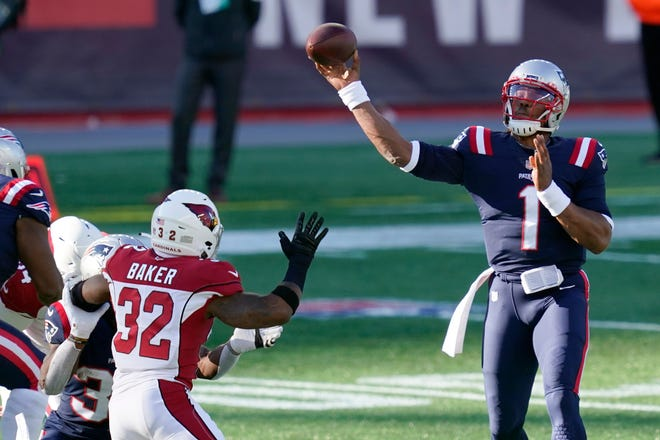 New England Patriots quarterback Cam Newton (1) passes under pressure from Arizona Cardinals safety Budda Baker (32) in the first half of an NFL football game, Sunday, Nov. 29, 2020, in Foxborough, Mass.