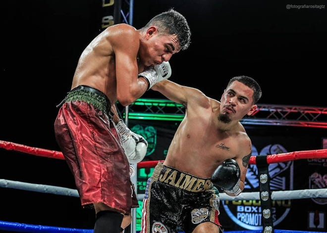 Stockton's Manuel Jaimes lands a punch against Christian Santiago Vazquez in Tijuana, Mexico. Jaimes won the WBC Youth World Light Title