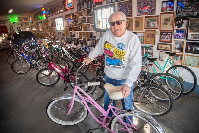 Pete Paulsen checks out some of the bicycles that he's collected for his Bikes  for Kids Christmas Giveaway event on Dec. 12 at his French Camp ranch. Paulsen has gotten about 200 bikes but needs help to fix and refurbish them before the event.