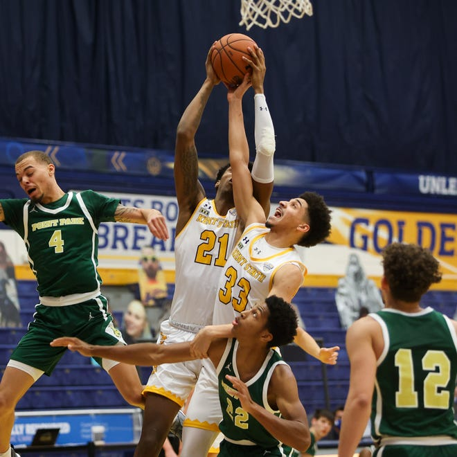 Kent State senior forward Justyn Hamilton (back) and freshman guard Jeremiah Hernandez fight for a rebound during a game against Point Park played earlier this season at the M.A.C. Center.