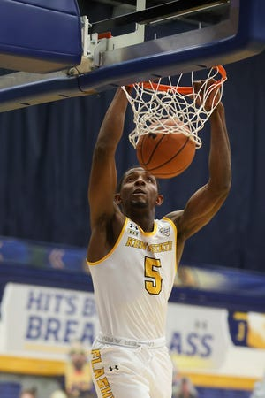 Kent State senior forward Danny Pippen is pictured throwing down a dunk during Wednesday night's 2020-21 season-opening victory over Point Park at the M.A.C. Center.