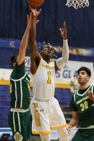 Kent State senior guard Mike Nuga puts up a shot between a pair of Point Park defenders during Wednesday night's game at the M.A.C. Center.