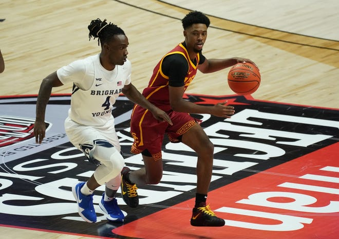 USC's Tahj Eddy drives on BYU's Brandon Averette (4) during the second half of Tuesday's game in Uncasville, Conn. The Trojans play Connecticut on Thursday.