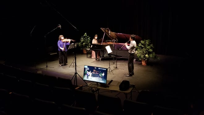 Violist Jessica Lambert, from left, Grace Choi at the piano and clarinetist Wonkak Kim on the right.