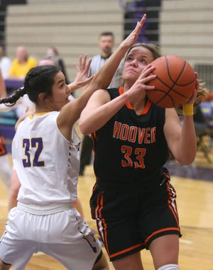 Emily Walker (33) of Hoover drives for the basket while being guarded by Halle Ignacio (32) of Jackson during their game at Jackson on Wednesday.