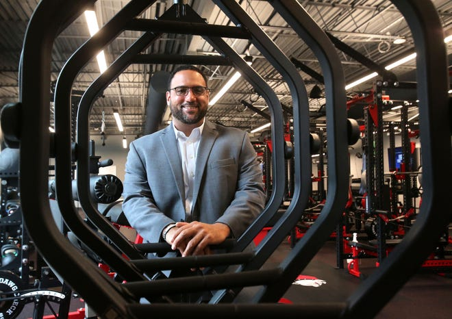 Antonio Hall, McKinley High athletic director, is a co-founder of Canton Out of Canton, a new charitable group started by ex-athletes. He's shown here in the school weight room.