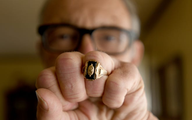 John Schick lost his Hoover High class ring 53 years ago, which was recently found for him by metal detector owner Scott Brown, of Doylestown, in the yard of the home Schick grew up in.