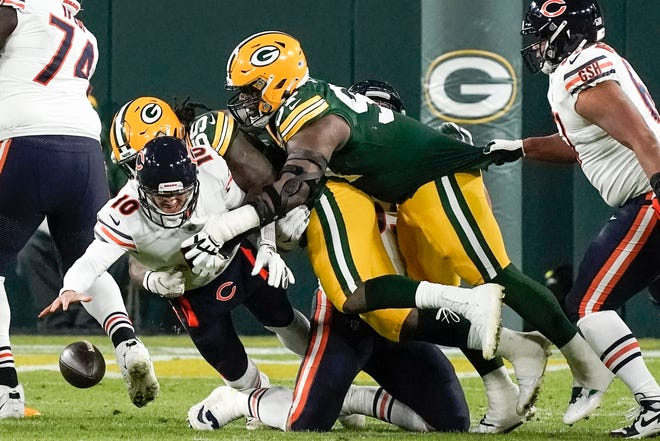 Chicago Bears quarterback Mitchell Trubisky fumbles the ball during the first half against the Green Bay Packers on Sunday in Green Bay, Wis. Packers linebacker Preston Smith recovered and returned the fumble for a touchdown. MORRY GASH/THE ASSOCIATED PRESS