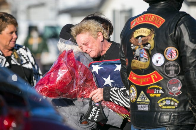 Belinda Swinney, center, is greeted by people who gathered at the 400 block of Wilshire Drive on Thursday, Dec. 3, 2020, in Machesney Park, to honor her son, U.S. Army Chief Warrant Officer 3 Dallas Garza, 34, who was killed in a military helicopter crash on Nov. 14 in Egypt.