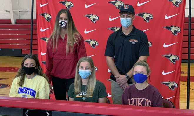 Five student/athletes from Cardinal Mooney Catholic signed their letters of intent Thursday: back row: Skye Ekes/Florida State (volleyball) and Christian Laureano/Mercer (lacrosse), front Row: Zoie Zanoni/Limestone (lacrosse); Rachel Jarrett/St. Leo (track and field and cross country) and Mary Page/Virginia Tech (volleyball).