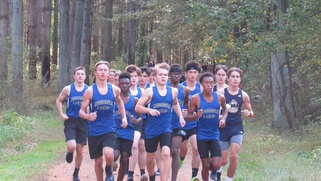 The Middletown High School boys cross country team races Delaware Military Academy Oct. 19 at Blackbird State Forest.
