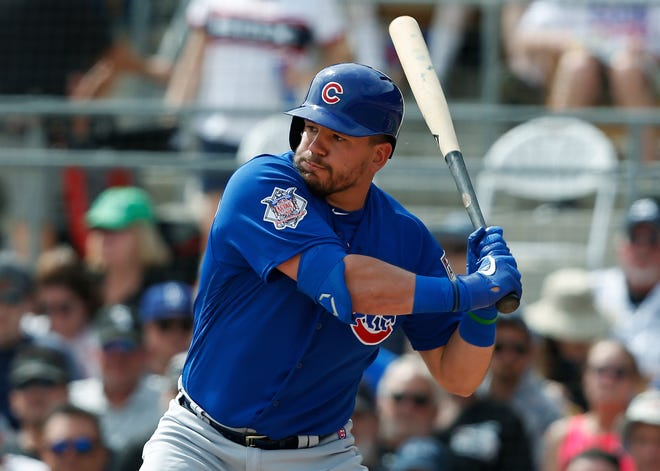 Kyle Schwarber bats during a March 15, 2019 spring training baseball game against the Chicago White Sox in Glendale, Ariz. Kyle Schwarber and Albert Almora Jr. became free agents Wednesday.