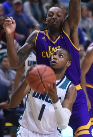 Chris Flemmings of UNCW goes up for a shot against ECU during the teams' December 2016 matchup at Trask Coliseum. The longtime rivals meet again Monday in a game that ECU is paying $70,000 to UNCW for playing.