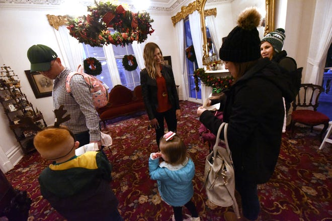 Lori Baird talks with guest during a Christmas Stroll Through the Past at the Bellamy Mansion Museum Saturday Dec. 14, 2019 in downtown Wilmington, N.C.