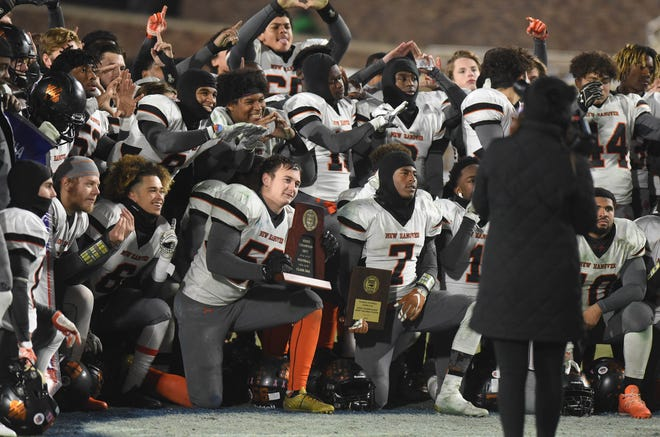 New Hanover players celebrate following a 27-17 victory against A.C. Reynolds during the 3AA football state championship at Wallace Wade Stadium on the campus of Duke University in Durham, NC, Saturday, December 9, 2017.