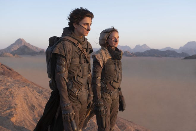 "Timothee Chalamet, left, and Rebecca Ferguson star in ""Dune."" Warner Bos. Pictures on Thursday announced that all of its 2021 film slate will stream on HBO Max at the same time they play in theaters."