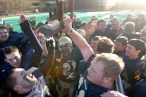 The undefeated Shrewsbury High School football team celebrates after rallying for a 21-17 victory over Westfield in the Central/Western Mass. Divisiion 2A Super Bowl in 2007.