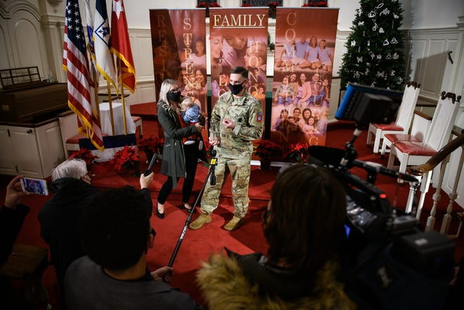 The Fort Bragg Family of the Year, Sgt. 1st Class Justin and Tawni Dixon, talk to members of the media on Wednesday.