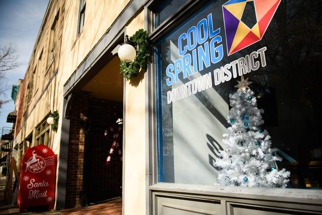A Christmas tree in the front window of the Cool Spring Downtown District office on Dec. 3.