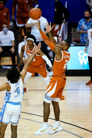 Matt Coleman III of Texas releases the game-winning shot over North Carolina's RJ Davis during the final seconds of the Maui Invitational championship game Wednesday in Asheville.