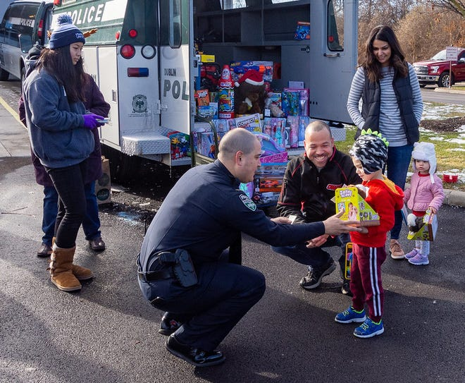 "Dublin Police Department Chief Justin Páez talks with residents and children during the 2019 ""Fill a Cruiser"" holiday toy drive. This year's toy drive is scheduled from 10 a.m. to 1 p.m. Dec. 19 at the Dublin Justice Center, 6565 Commerce Parkway."